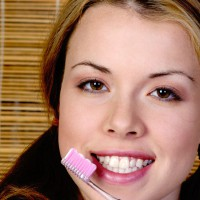 Beautiful woman holding a tooth brush