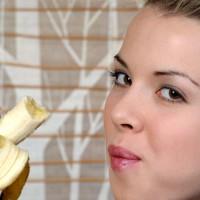 Beautiful woman eating a banana
