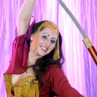 Belly dancer with a sword