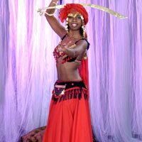Exotic belly dancer with a sword