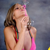 Beautiful girl blowing some bubbles