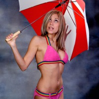 Beautiful girl in bikini with an umbrella