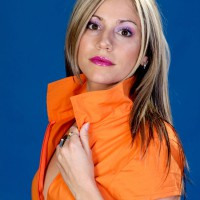 Beautiful woman in orange jumpsuit